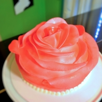 "Pink Rose Cake   8"" round cake covered in fondant petals to look like a giant rosebud."