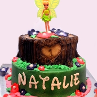Tinkerbell Cake Buttercream decorated Tinkerbell cake with fondant flowers.