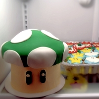 Super Mario Mushroom Cake And Cupcakes   Super Mario themed kids birthday cake and cupcakes.