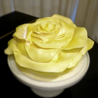 "Giant Yellow Rose Cake 10"" round cake made to look like a giant rose with fondant petals."