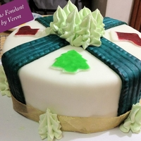 Christmas Fondant Cake Fondant decors were hand painted to give it a rustic royal look