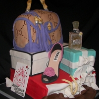All Things Shopping   stacked shopping cake with pulled sugar perfume and fondant shoe