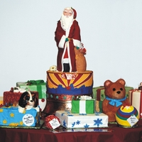 Santa With Presents And Toys cake santa with cake presents and toys for the state of arizona serves 500