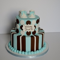 A 6 Inch And A 9 Inch Baby Shower Cake With Gum Paste Booties A 6 inch and a 9 inch baby shower cake with gum paste booties!