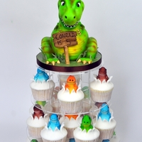 Dinosaur Cupcake Tower Cupcakes inspired by Planet cake and I have a step by step of how to make the top cake on my facebook page at 'Suzie B Cakes'