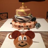 3 Tier Safari Cake And Monkey Smash Cake 3 tiers, fondant covered - girafee, zebra, and leopard print. I airbrushed the leopard print. The monkey cake is fondant covered and...