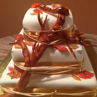 Fall Themed Wedding Cake Fondant Covered Branch Amp Leaves Are Fondant As Well I Used A Hay Like String To Keep The Branch In Tact With fall themed wedding cake. Fondant covered, branch & leaves are fondant as well. I used a hay like string to keep the branch in tact...