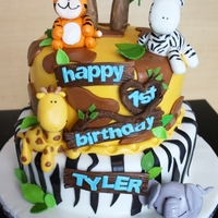 Jungle Themed Birthday Cake For Kids   Here's a Jungle Themed Birthday Cake for a boy turning 1! There's a heart in there somewhere, can you see it? :)