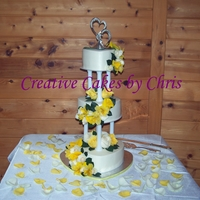 Yellow And White Wedding Cake 3 tier hearts, buttercream, fresh flowers added by me at the venue.