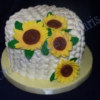 Petal Effect And Sunflowers Petal effect with SMBC. Fondant Sunflowers. Tutorial provided by Royal Bakery. Chocolate Cake, Irish Cream filling.