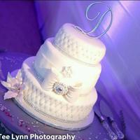 White And Silver Wedding Cake.   *White and silver three tier wedding cake.