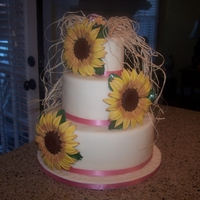 "Sunflower Wedding Cake 3 Tier Almond Cake, with Raspberry Filling, Almond Buttercream Icing, Ivory Carma Fondant. Huge Sunflowers, 6 1/2"" in diameter, made..."