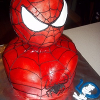 Spider-Man 5Th Birthday 3D Spider-man head cake, head made from rice krispies, torso vanilla cake, covered in fondant, air brushed red, with black pipe work. 9&...