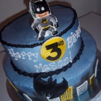 Batman funfetti cake filled and frosted in buttercream, airbrushed, with hand painted fondant batman, batman logo, buildings, and 3rd birthday...