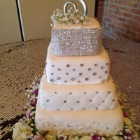 Bling Wedding Cake For tiered marble buttercream, chocolate buttercream, white raspberry, and marble fudge covered in fondant with bottom tier scroll work,...