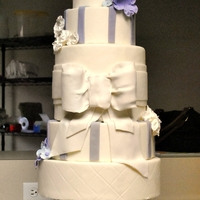 Classy Wedding Cake classy and elegant purple wedding cake with sugar flowers.