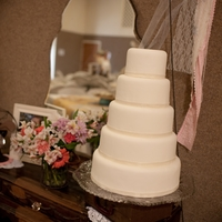 Simple 5 Tier White Cake With Fondant This bride wanted a simple cake to not take away from her vintage decor.