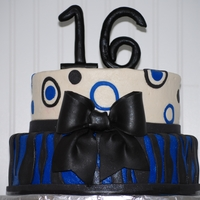 Sweet 16 This is a sweet 16 bithday cake made of buttercream with fondant accents. LOVE how it turned out!