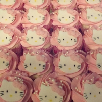 Hello Kitty Vanilla/pink vanilla butter cream, fondant Hello Kitty's, birthday cupcakes. These turned out so cute!!