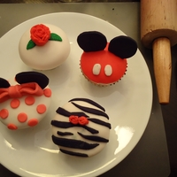 Cupcakes Mickey, Minnie, Zebra, and Rose Cuppie. Buttercream with fondant over top with fondant decorations.