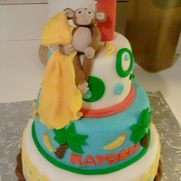 Lil Monkeys First Birthday Baby monkey holding his blankie. Fun & festive with bright colors. I pushed a regular birthday candle into the center of a fondant &...