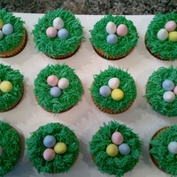 Easter Egg Cupcakes Made for a kindergarten class. Very easy & super cute!! I used the grass tip to cover the cupcakes and laid 3 Cadbury candy eggs in the...