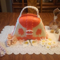 Purse Cake. Chocolate cake topped with MMF.