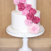 Raspberry Roses Small rose cascade cake in shades of pink.