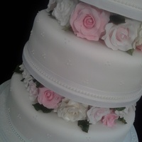 4 Tier 'rose' Wedding Cake With Personalised Topper. Hand made sugar paste roses.
