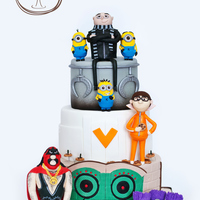 Despicable Me This cake was designed by my 8 year old son. Each tier was made to look like the villains lair. The characters were all made from fondant...