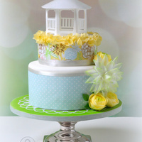 Cake With Wafer Paper Gazebo And Flowers (Ranunculus And Chrysantheum) Cake with wafer paper gazebo and flowers (ranunculus and chrysantheum) and frosting sheets.
