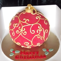 Christmas Bauble chocolate mud cake with red fondant and hand painted piping