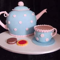 Teapot And Cup   Teapot and cup are cake and the biscuits are gumpaste