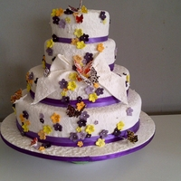 Blossoms And Butterflies.   summer wedding cake.