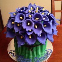 Flower Cakes Purple Calla Lily Cake. 2 (3 layer) tiers of cake with 8 inch hemisphere pan cake on top. Covered with 60 handmade fondant & tylose...