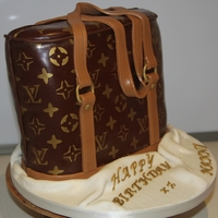 L V Handbag   vanilla sponge cake for a 60th birthday its a replica old L.V bag this lady has had for years