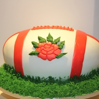 Rugby Ball Cake   chocolate cake covered in fondant with buttercream grass