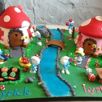 The Smurfs' Village Smurfs are plastic figurines provided by client. Everything else is made of fondant. Thanks for looking :)