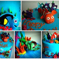 Nemo Birthday Cake Vanilla Cake with vanilla choco chip buttercream covered with vanilla frosting.All details and characters are hand-modeled fondant.Thanks...