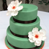 Fall Wedding Cake Green and brown color take from the bride gown.Bottom tier is red velvet cake with cream cheese buttercreammiddle tier is chocolate mud...