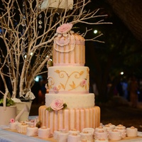 Shabby Chic Wedding Four tier banana cake with pineapple buttercream filling and 100 mini VanillaBean cakes with banana buttercream filling all covered in dark...