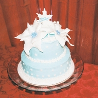 Winter Anniversary Cake Vanilla buttercream with gumpaste-fondant snowflakes and poinsettias.