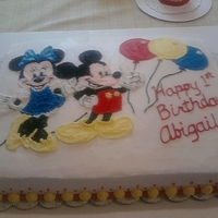 Mickey And Minnie Cake I copied Mickey and Minnie Mouse from a coloring book and used piping gel to transfer the image onto the cake, then piped in the coloring....