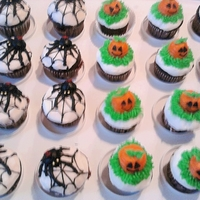 Halloween Mini Cupcakes Devil's Food mini cupcakes with vanilla buttercream, piped on spiders and jack-o-lanterns.