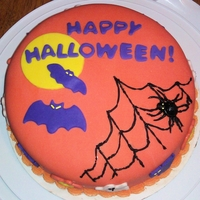 Halloween Cake Devil's Food (of course) with too much chocolate buttercream (because I like it) covered in fondant with cutouts and piped on spider...