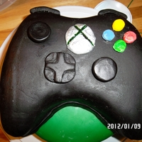 Controller Cake this one I did for my hubby to take to work. He is a computer games programmer and the guys at the office went wild over this creation. I...