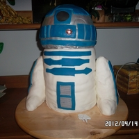 R2D2 R2D2 is a 5 layer cake, the dome section is made of a vanilla cake with butter cream filling. There is a working LED imbedded into the cake...
