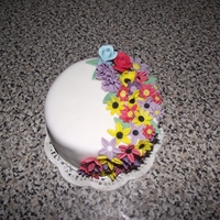A Floral Minature This is the smallest cake i have ever made,it's only 4inches in diameter and the flowers were all made using mini plunge cutters,