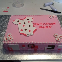 Baby Shower Cake - Geometric - Girl It's a Girl baby shower cake with geometric shapes around sides