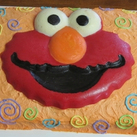 Elmo 2Nd Birthday Elmo candy plaque on buttercream cake, with second cake candy melts and buttercream